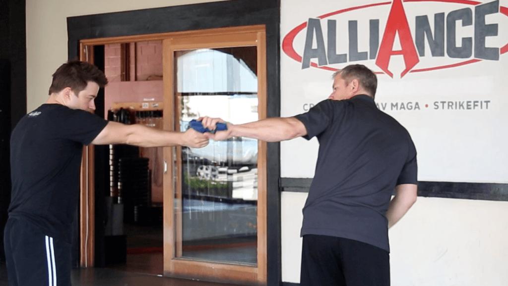 Krav Maga Technique - Hand Gun From Behind At A Distance